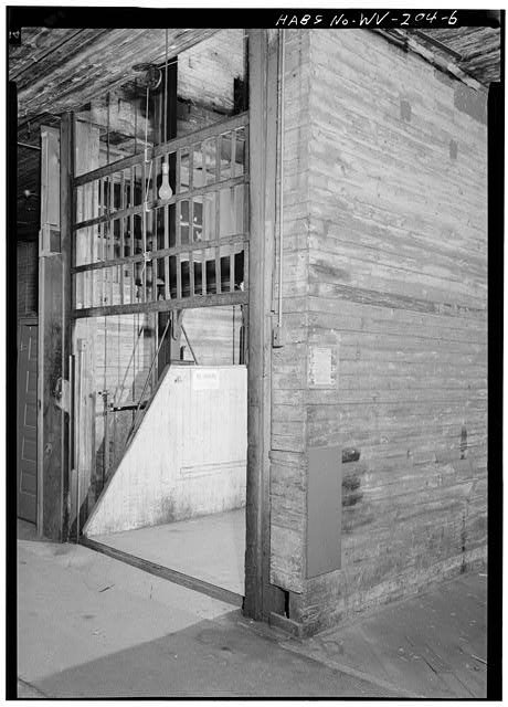 6.  FREIGHT ELEVATOR, FIRST FLOOR, SOUTH WALL OF WEST (REAR) SECTION OF BUILDING - Joseph Speidel & Company Building, 1417 Main Street, Wheeling, Ohio County, WV
