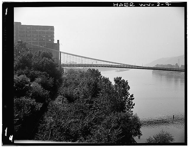 7.  NORTH ELEVATION OF WHEELING (EAST) HALF OF BRIDGE. - Wheeling Suspension Bridge, Spanning East channel of Ohio River at U.S. Route 40, Wheeling, Ohio County, WV