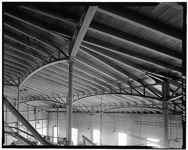 8.  DETAIL VIEW OF CAST-IRON OCTAGONAL COLUMNS AND CAST-IRON TRUSSES SUPPORTING SHED PORTION OF ROOF. - Baltimore & Ohio Railroad, Martinsburg West Roundhouse, East End of Race & Martin Streets, Martinsburg, Berkeley County, WV