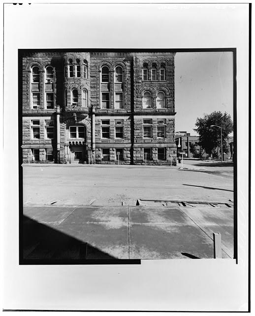 6.  SOUTH PORTION OF WEST FACADE Copy photograph of photogrammetric plate LC-HABS-GS13-B-1974-607R. - Old Wood County Courthouse, Parkersburg, Wood County, WV
