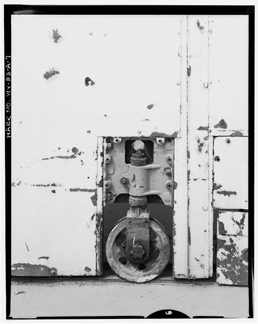 7.  Detail of wheel mechanism on lower portion of door on east side (rear) of hangar - Cheyenne Airfield, United Airlines Hangar, 200 East Eighth Avenue, Cheyenne, Laramie County, WY