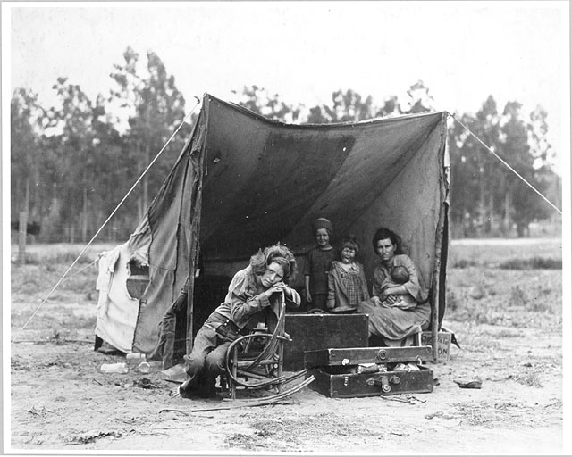 Depression era photo of woman and children living in tent.