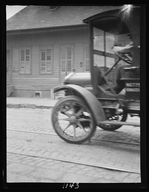 Car driving down a street, New Orleans or Charleston, South Carolina