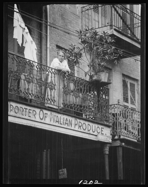 Woman leaning on a balcony, New Orleans