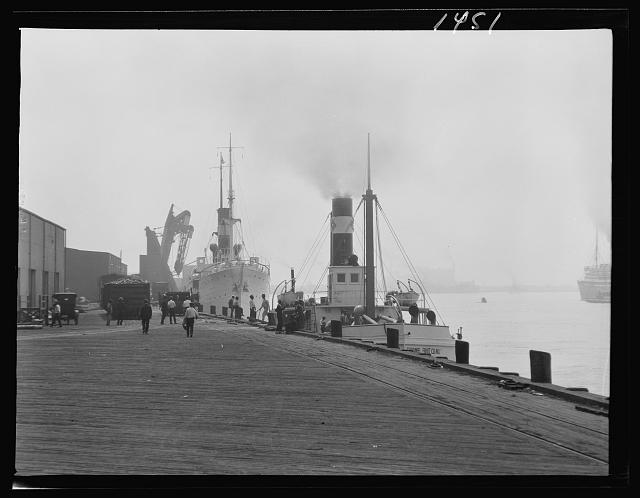 Ships at dock, New Orleans or Charleston, South Carolina