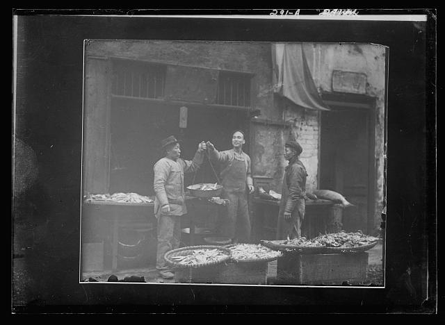 Weighing fish, Chinatown, San Francisco