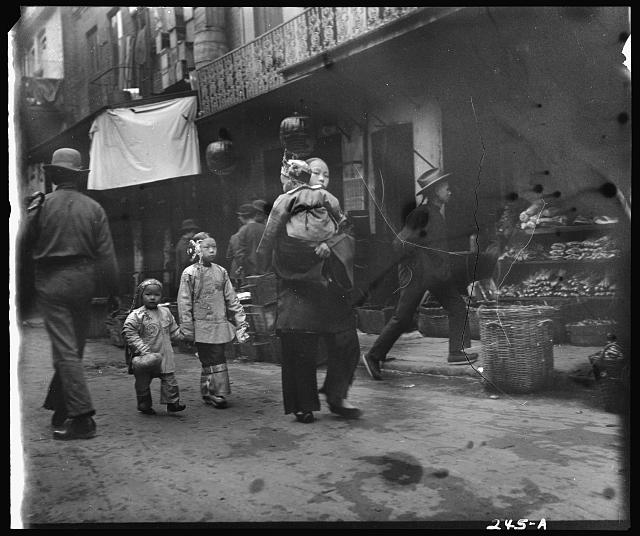 Woman and children walking down a street, Chinatown, San Francisco