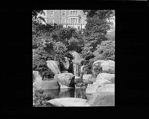 Garden and house at Kijkuit, John D. Rockefeller's estate, designed by William Welles Bosworth
