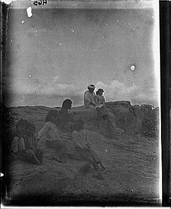 Group of American Indian children seated on rocks