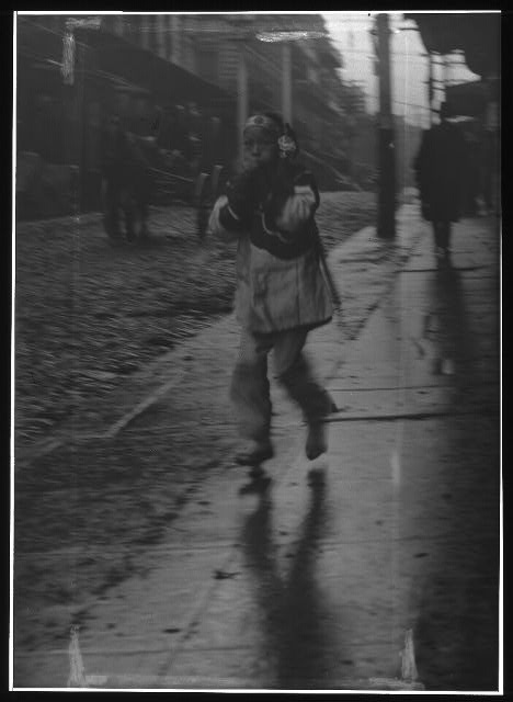 Girl running down a street, Chinatown, San Francisco