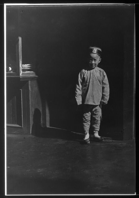 Boy in doorway of lamp store, Chinatown, San Francisco