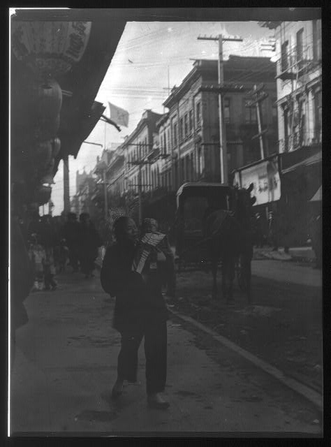 An amah holding a child, Chinatown, San Francisco