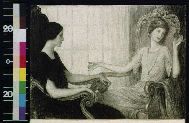 [Two women seated facing each other]