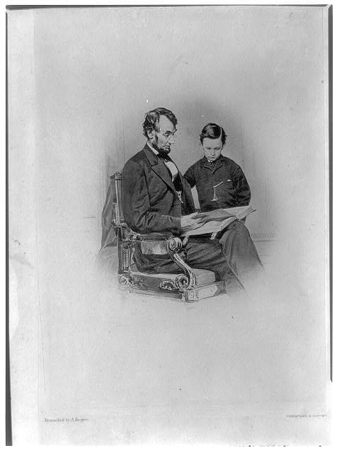 [Abraham Lincoln and his son Tad looking at an album of photographs]