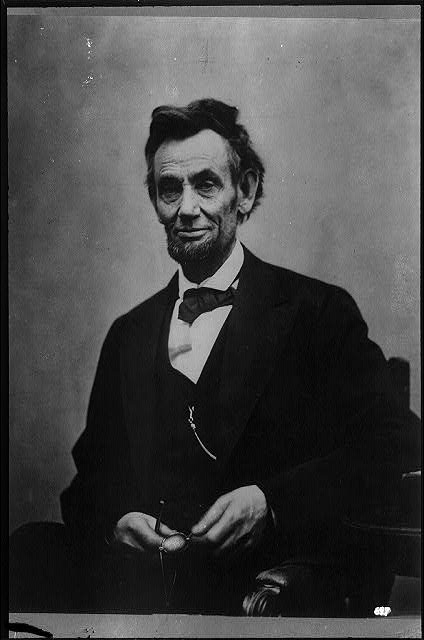 [Abraham Lincoln, half-length portrait, seated, with pencil and spectacles retouched]