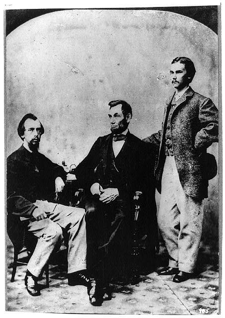 [President Abraham Lincoln seated with his secretaries John Hay and John Nicolay]
