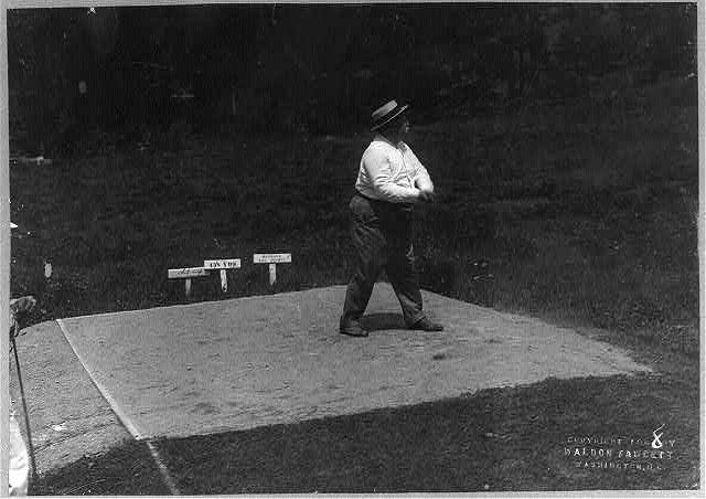 Taft teeing off on golf course