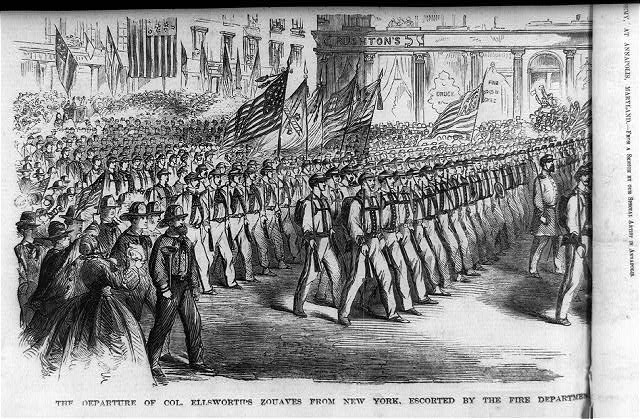 The departure of Col. Ellsworth's Zouaves from New York, escorted by the fire department