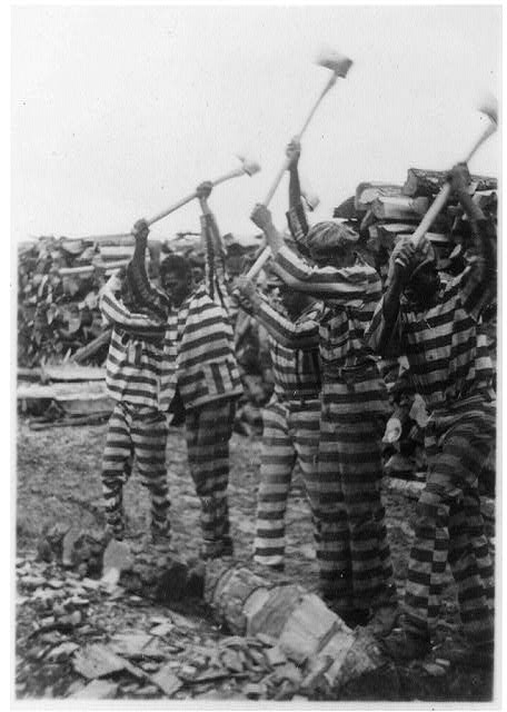 [African American convicts working with axes, Reed Camp, South Carolina]