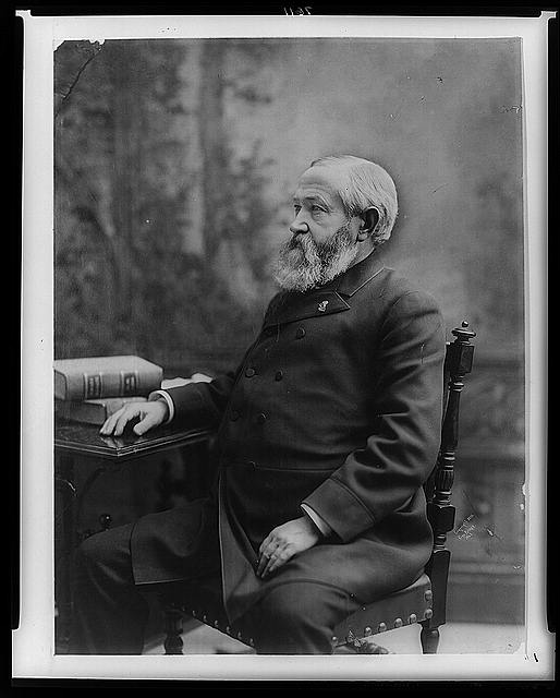 [Benjamin Harrison, three-quarter length portrait, seated, facing left, with right hand on table]