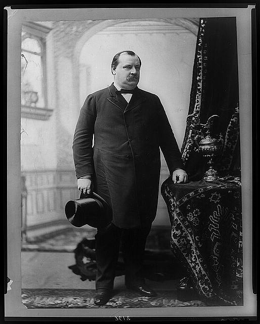 [Grover Cleveland, full-length portrait, standing, facing right, holding hat]