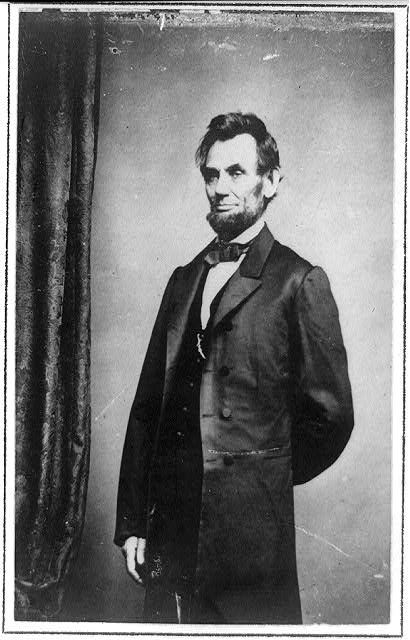 [Three-quarter length portrait of Presidenet Abraham Lincoln standing]