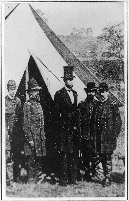 [President Abraham Lincoln posed with Union officers and soldiers during his visit to Antietam, Maryland, October 3, 1862]