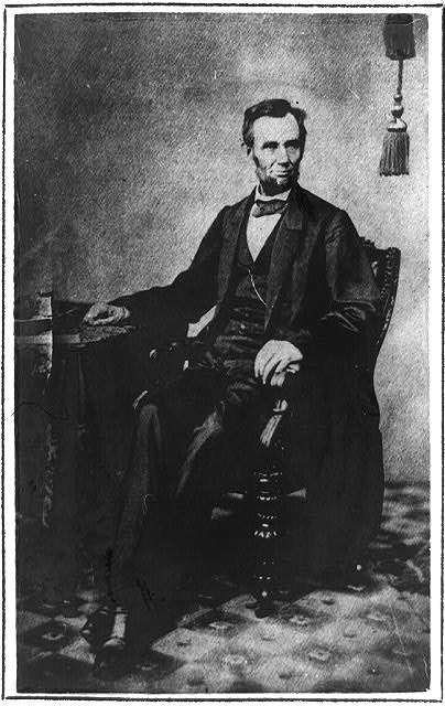 "[President Abraham Lincoln, full-length portrait, seated in a ""Brady"" chair, November 8, 1863]"