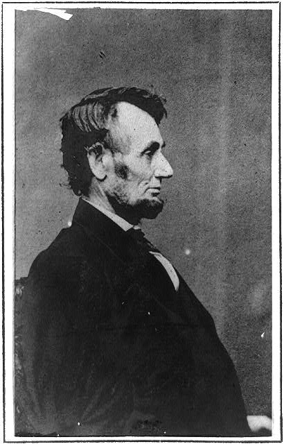 [Portrait profile of President Abraham Lincoln, facing right and seated]