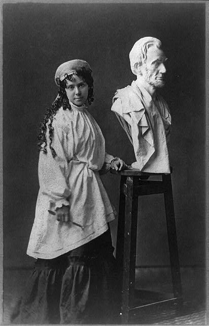 Vinnie Ream at work upon her Lincoln bust which rests upon the stand she used in the White House while President Lincoln posed for her