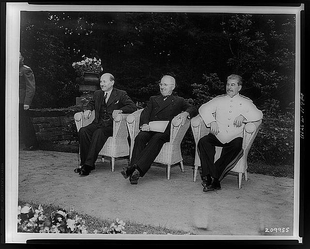 [Clement Attlee, Harry Truman, and Joseph Stalin, seated outdoors at Berlin conference]