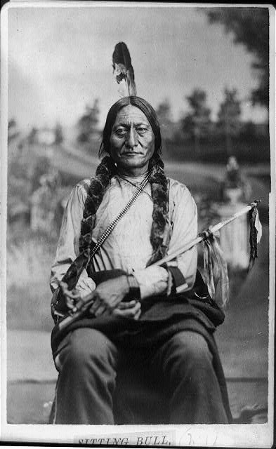 [Sitting Bull, three-quarter-length portrait, seated, facing front, holding calumet]