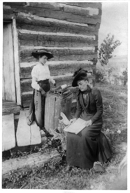 Picture of Mrs. Norah Gridley, cousin of Mrs. Abraham Lincoln, and Miss May Coleman, the typewriter, taken outside of and near the corner of the Lincoln Cabin, August 9/91