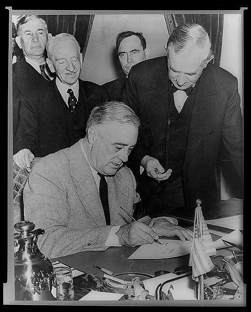 President Roosevelt signing the Declaration of war against Japan