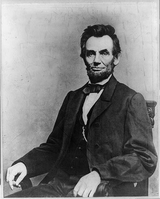 [President Abraham Lincoln, portrait, seated and facing front]