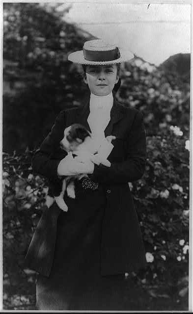 Alice Roosevelt in riding clothes, with dog
