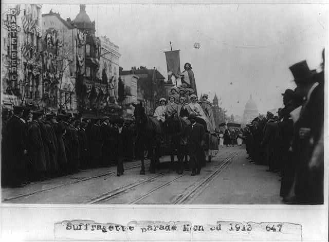 [Suffragette parade on Pennsylvania Ave., Washington, D.C. - women on wagon]