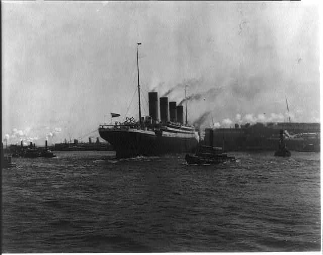 [The S.S. OLYMPIC, 1911: Tugs maneuvering ship into pier, New York Harbor]