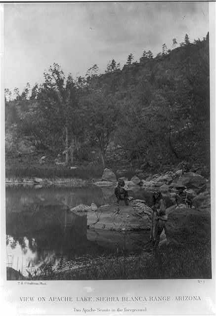 View on Apache Lake, Sierra Blanca Range, Arizona. Two Apache scouts in the foreground