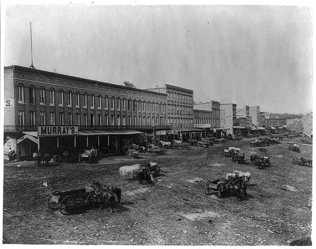 [View of Main Street, Peru, Illinois, showing Murray's Dry Goods, and several horses and wagons]