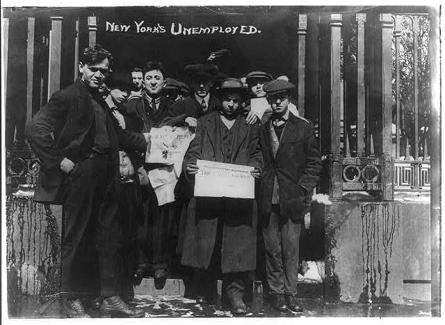 [Group of unemployed workers holding up newspaper, The Voice of the People, New York City]