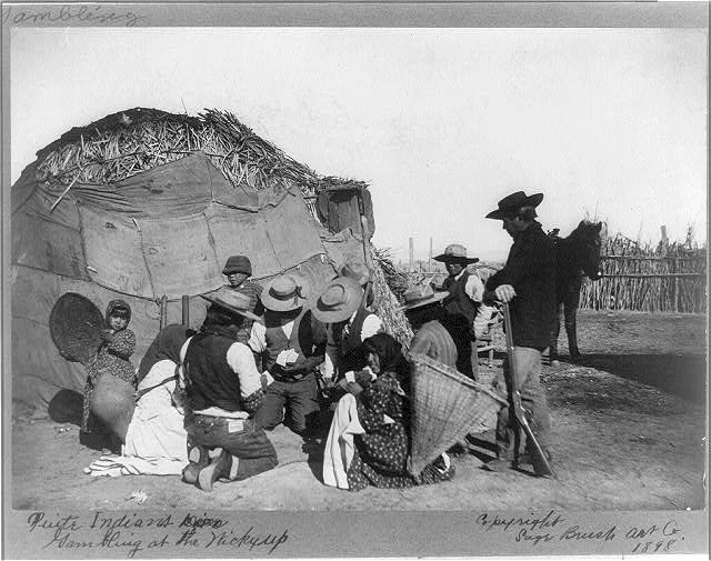 Paiute Indians gambling at the wickyup