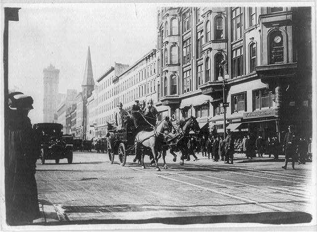 [Horse-drawn fire engines in street, on their way to the Triangle Shirtwaist Company fire, New York City]