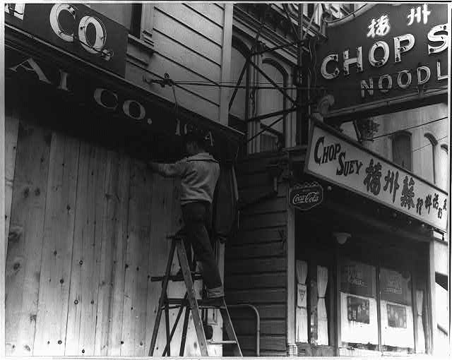 [Japanese-American boarding up store front before evacuation, San Francisco]
