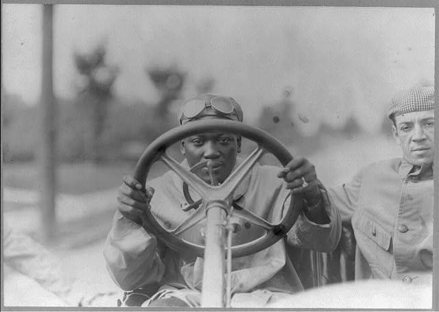 Champion Jack Johnson at wheel of his 90 horse power Thomas Flyer