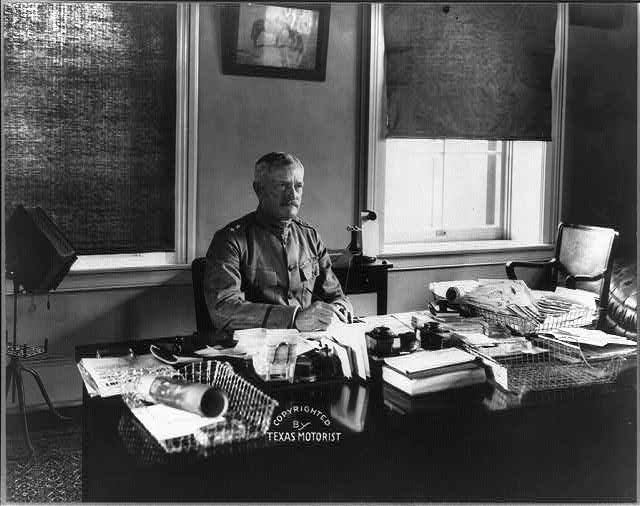[Major General John J. Pershing, half-length portrait, seated at desk]