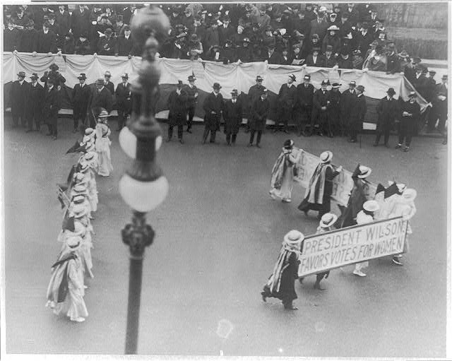 "[Suffragettes parading with banner ""President Wilson favors votes for women"". N.Y.C. ca.1916]"