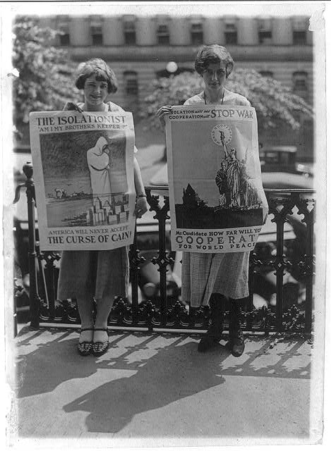 Miss Goldie Dunn and Miss Louise Hiatt, of the National Council for the Prevention of War, holding isolationist posters