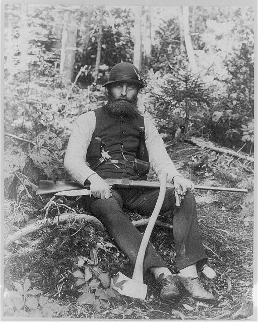 [Bearded man armed with ax, rifle, hunting knife, and two pistols, Maine]