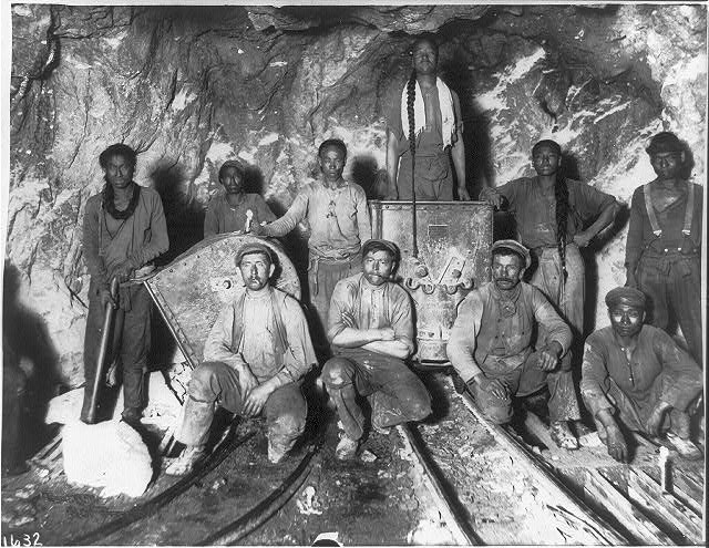 Black, Chinese and White laborers in a gold mine in South Africa